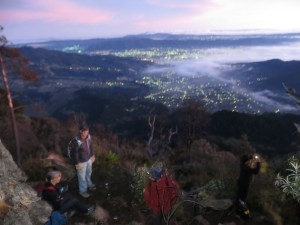 Morning fog and hikers over Quetzaltenango.