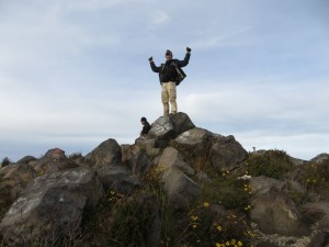Victory! On top of the tippy top boulder at the summit!
