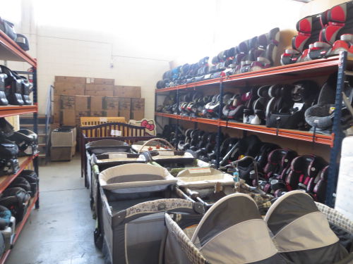 A large selection of cribs, playpens and car seats.